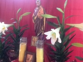 St. Joseph with candles and lilies.