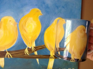 In my sister's house we noticed that another sister (an artist) had painted this beautiful picture of birds.  She also took that picture and had it emblazoned on coffee mugs!