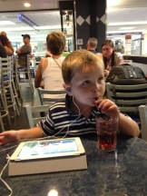 Sonny boy sips a Shirley Temple at the bar.