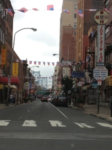 I actually really dig this view down Race St. (Philly).  Chinatown with the Ben Franklin Bridge in the distance.