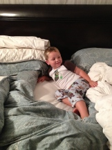 And here's sonny boy sleeping in Mommy and Daddy's bed.