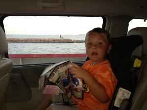 On the ferry (note the railing just beyond his window).