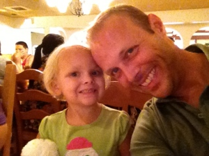 Daddy and daughter enjoying the evening.