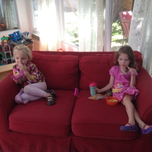Daughter (L) and friend (R) and the bright red couch.  Having a grand time until...