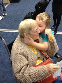 Sonny Boy give Grandma a kiss at the airport