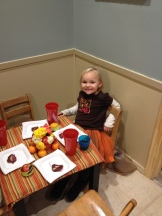 Baby girl shows off the kitten table.