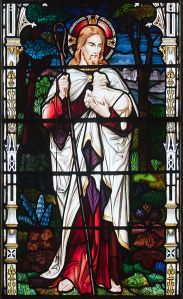 The Good Shepherd as depicted in stained glass, Church of St. Brendan the Navigator, Cork, Ireland Courtesy: Wikimedia Commons (pub. dom.)