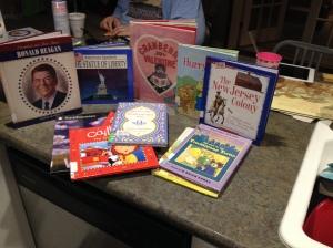 It was a group effort this week.  We've got books about NJ (Daddy's home state), President Reagan, Valentine's Day, and Caillou (whom I cannot stand).