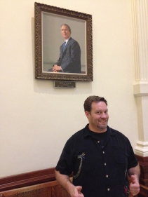 Virginia friend Matt stands beneath a portrait of the most recent governor of our fair state.