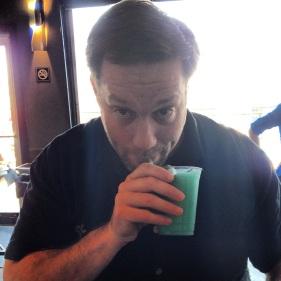 Matt enjoys a drink in Austin.