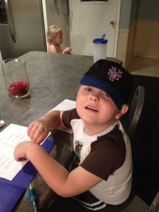 Sonny Boy writing his word list and showing how much he loves his Daddy's favorite ball club.  Let's go Mets!