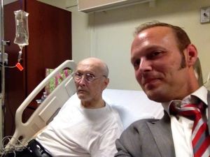 Dad, feeling a bit better and 24 hours after walking into the ER, poses for a hospital selfie with his youngest son.